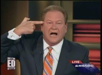 Ed Schultz finger to head.jpg