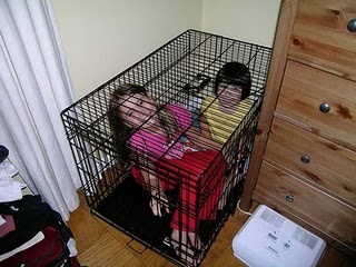 Caged kids.jpg