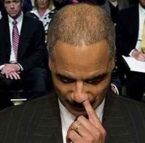 Eric-Holder-picks-nose.jpg