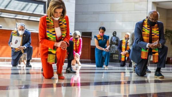Nancy Pelosi kneeling.jpg