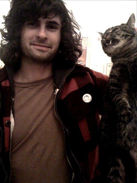 man w angry cat.jpg
